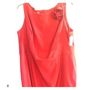 Pink/coral dress with rosette accent on front